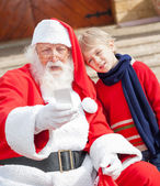 Santa Claus And Boy Taking Selfportrait Through Smartphone — Stock Photo