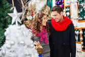 Couple With Bauble Basket In Christmas Store — Stock Photo