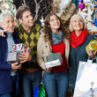 Happy Family Shopping In Christmas Store — Stock Photo