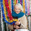 Woman Shopping For Tinsels At Christmas Store — Stockfoto