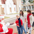 Santa Claus Offering Biscuits To Children — Stock Photo