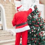 Santa Claus Decorating Christmas Tree — Stock Photo