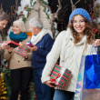 Beautiful Woman With Family In Christmas Store — Stock Photo