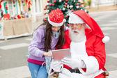 Girl And Santa Claus Using Digital Tablet — Stock Photo