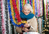Woman Shopping For Tinsels At Christmas Store — Stock Photo