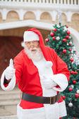 Confident Santa Claus Gesturing Thumbsup — Stock Photo