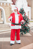 Santa Claus With Milk And Cookies In Courtyard — Stockfoto