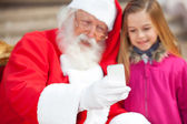 Santa Claus And Girl Taking Selfportrait Through Smartphone — Stock Photo
