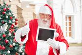 Santa Claus Gesturing Thumbsup While Holding Digital Tablet — Stock Photo