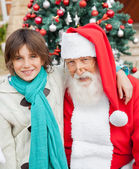 Happy Boy With Arm Around Santa Claus — Stock Photo