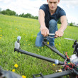 Stock Photo: TechniciFixing Propeller Of Surveillance Drone