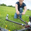 Technician Fixing Propeller Of Surveillance Drone — Stock Photo #31869289