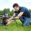 Technician Fixing Camera On UAV Helicopter — Stock Photo #31869307