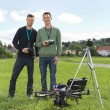 Engineers Standing By UAV Helicopter And Tripod — Stock Photo