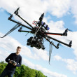 Technician Flying UAV Helicopter in Park — Stock Photo