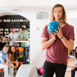 Confident Man Holding Bowling Ball in Club — Stock Photo