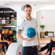 Confident Young Man With Bowling Ball in Club — Stock Photo
