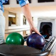 Stock Photo: Man's Hand Picking Up Bowling Ball From Rack
