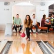 Woman Throwing Bowling Ball in Club — Stock Photo