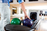 Man's Hand Picking Up Bowling Ball From Rack — Stock Photo