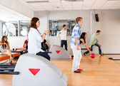 Young Friends Bowling in Club — Stock Photo