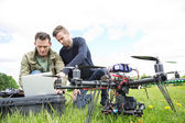 Engineers Using Laptop By UAV Octocopter — Stock Photo