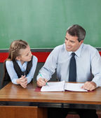 Professor And Little Girl Looking At Each Other At Desk — Stock Photo