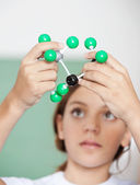 Teenage Schoolgirl Examining Molecular Structure — Stock Photo