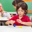 Boy Molding Clay At Classroom — Stock Photo