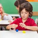 Boy Molding Clay At Classroom — Stock Photo #31908991