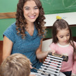 Teacher With Children Playing Xylophone In Kindergarten — Stock Photo