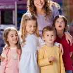 Young Teacher With Children In Kindergarten — Stock Photo #31909393