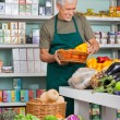 Stock Photo: SalesmWorking In Grocery Store