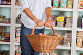 Midsection Of Man Holding Wicker Basket In Store — Stock Photo