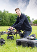 Young Technician Assembling UAV in Park — Stock fotografie