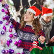 Stock Photo: Woman Shopping For Christmas Decorations