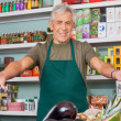 Salesman With Arms Outstretched Supermarket — Stock Photo