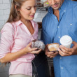Couple Holding Cakes And Coffee Cup At Grocery Store — Stock Photo #31977213