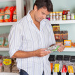 Man Choosing Product In Store — Stock Photo #31977487