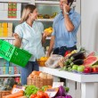 Stock Photo: Couple Shopping Vegetables In Supermarket