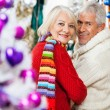 Happy Senior Couple At Christmas Store — Stock Photo