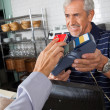 Customer Paying Through Mobile Phone In Store — Stock Photo