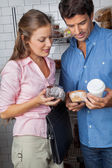 Couple Holding Cakes And Coffee Cup At Grocery Store — Stock Photo