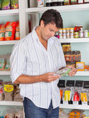 Man Choosing Product In Store — Stock Photo