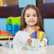 Cute Girl With Craft On Desk In Classroom — Stock Photo