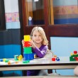 Girl Playing With Toys In Kindergarten — Stok fotoğraf
