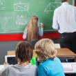 Little Schoolboys Using Digital Tablet At Desk — Stock Photo