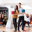 ������, ������: Young Man And Woman With Bowling Balls in Club