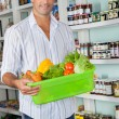 Stock Photo: MWith Basket Of Fresh Vegetables Standing In Store