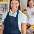 Saleswoman With Female Customer In Background — Stockfoto